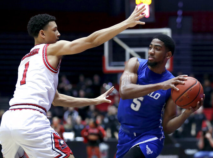 Buffalo guard C.J. Massinburg, right, looks pass against Northern Illinois guard Trendon Hankerson during the first half of an NCAA college basketball game Tuesday, Jan. 22, 2019, in DeKalb, Ill. (AP Photo/Nam Y. Huh)