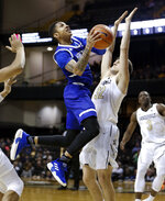 UNC Asheville guard Cress Worthy drives against Vanderbilt forward Matt Ryan (32) in the second half of an NCAA college basketball game Monday, Dec. 31, 2018, in Nashville, Tenn. (AP Photo/Mark Humphrey)