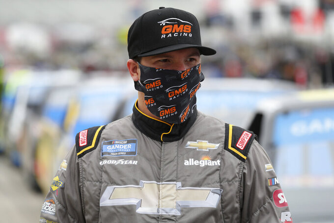 NASCAR Texas Trucks Series driver Sheldon Creed stands on pit road before a NASCAR Cup Series auto race at Texas Motor Speedway in Fort Worth, Texas, Sunday, Oct. 25, 2020. (AP Photo/Richard W. Rodriguez)