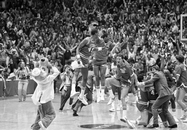 FILE - In this April 4, 1983, file photo, a high jumping Cozell McQueen (45), left center, and teammates celebrate defeating Houston 54-52 in the NCAA college basketball championship game in Albuquerque, N.M. (AP Photo/File)
