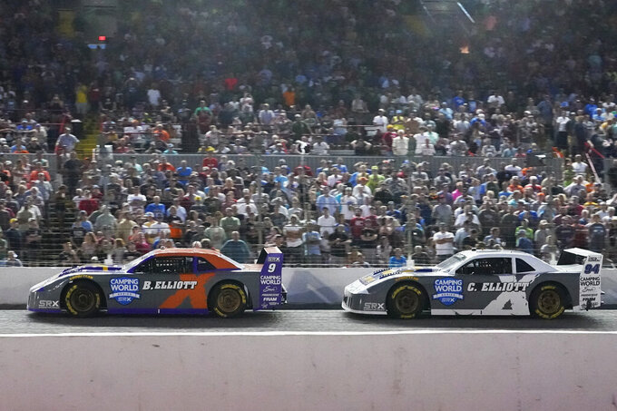 Bill Elliott (9) leads Chase Elliott during the SRX Series auto race Saturday, July 17, 2021, in Nashville, Tenn. (AP Photo/Mark Humphrey)