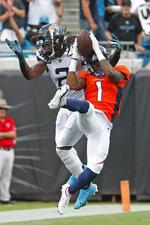 Jacksonville Jaguars safety Rayshawn Jenkins, left, breaks up a pass intended for Denver Broncos wide receiver KJ Hamler (1) during the first half of an NFL football game, Sunday, Sept. 19, 2021, in Jacksonville, Fla. (AP Photo/Stephen B. Morton)