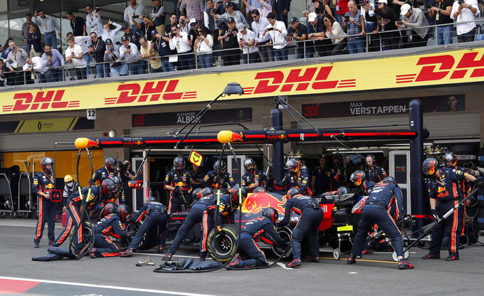 Pit crew change tires of the car of Red Bull driver Max Verstappen, of the Netherlands, during the Formula One Mexico Grand Prix auto race at the Hermanos Rodriguez racetrack in Mexico City, Sunday, Oct. 27, 2019. (AP Photo/Marco Ugarte)
