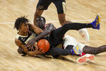 Purdue guard Jaden Ivey (23) and Nebraska forward Lat Mayen (11) fight for the ball in the first half during an NCAA college basketball game Saturday, Feb. 20, 2021, in Lincoln, Neb. (AP Photo/John Peterson)
