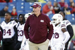 FILE - In this Dec. 30, 2019, file photo, Mississippi State head coach Joe Moorhead watches as players warm up before the Music City Bowl NCAA college football game against Louisville, in Nashville, Tenn.  Two people with knowledge of the situation say Mississippi State has fired coach Joe Moorhead after just two seasons. They spoke to The Associated Press on condition of anonymity because an announcement had not yet been made by the school. A meeting was scheduled Friday, Jan. 3, 2020, with Moorhead and athletic director John Cohen.(AP Photo/Mark Humphrey, File)