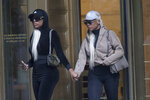 Shannade Clermont, right, and her twin sister Shannon leave Federal court in New York after her arraignment, Wednesday, July 11, 2018. Shannade Clermont, a former cast member of the television reality series
