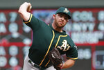 Oakland Athletics pitcher Liam Hendriks throws against the Minnesota Twins in the ninth inning of a baseball game Sunday, July 21, 2019, in Minneapolis. The Twins won 7-6. Hendriks picked up the loss. (AP Photo/Jim Mone)