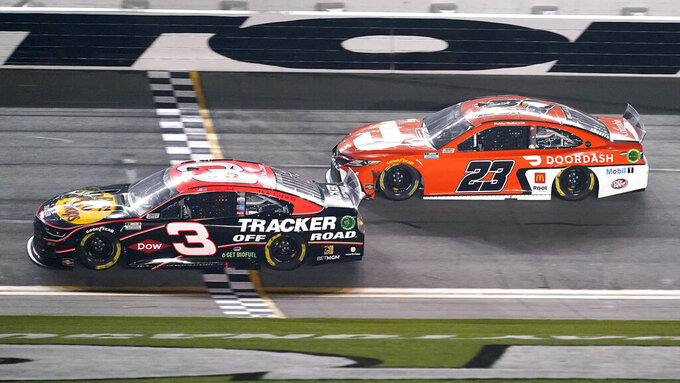 Austin Dillon (3) crosses the finish line in front of Bubba Wallace (23) to win the second of two qualifying auto races for the NASCAR Daytona 500 at Daytona International Speedway, early Friday, Feb. 12, 2021, in Daytona Beach, Fla. (AP Photo/John Raoux)