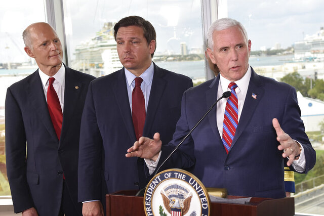 Vice President Mike Pence, right, along with Florida Sen. Rick Scott, left, and Gov. Ron DeSantis, center, speaks to the media after a meeting with cruise line company leaders to discuss the efforts to fight the spread of the COVID-19 coronavirus, at Port Everglades, Saturday March 7, 2020, in Fort Lauderdale, Fla. (AP Photo/Gaston De Cardenas)