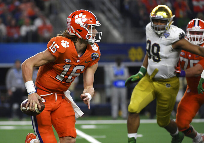 Clemson quarterback Trevor Lawrence (16) is pressured out of the pocket in the second half of the NCAA Cotton Bowl semi-final playoff football game against Notre Dame on Saturday, Dec. 29, 2018, in Arlington, Texas. (AP Photo/Jeffrey McWhorter)