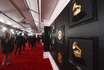 FILE - A view of the red carpet appears prior to the start of the 62nd annual Grammy Awards on Jan. 26, 2020, in Los Angeles. The Recording Academy told The Associated Press on Tuesday, Jan. 5, 2021, that the annual show would shift from its original Jan. 31 broadcast to March 14. The Grammys will be held in Los Angeles at the Staples Center. (Photo by Jordan Strauss/Invision/AP, File)