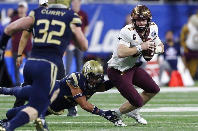 Minnesota quarterback Tanner Morgan (2) is sacked by Georgia Tech defensive back Jalen Johnson during the first half of the Quick Lane Bowl NCAA college football game, Wednesday, Dec. 26, 2018, in Detroit. (AP Photo/Carlos Osorio)
