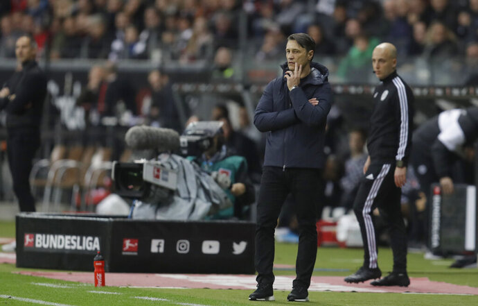 Bayern's head coach Niko Kovac reacts as he watches his team play during a German Bundesliga soccer match between Eintracht Frankfurt and Bayern Munich in the Commerzbank Arena in Frankfurt, Germany, Saturday, Nov. 2, 2019. (AP Photo/Michael Probst)