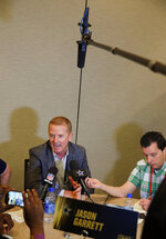 Dallas Cowboys head coach Jason Garrett speaks to the media during the NFC/AFC coaches breakfast during the annual NFL football owners meetings, Tuesday, March 26, 2019, in Phoenix. (AP Photo/Matt York)