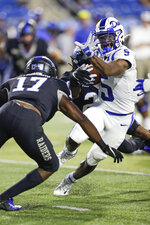 Duke wide receiver Jalon Calhoun (5) carries the ball against Middle Tennessee safety Kylan Stribling (17) in the first half of an NCAA college football game Saturday, Sept. 14, 2019, in Murfreesboro, Tenn. (AP Photo/Mark Humphrey)