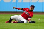 Cleveland Indians' Harold Ramirez dives for a double hit by Detroit Tigers' Nomar Mazara during the fifth inning in the first baseball game of a doubleheader, Wednesday, June 30, 2021, in Cleveland. (AP Photo/Tony Dejak)
