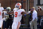 Clemson's Travis Etienne (9) celebrates his touchdown run against Wake Forest during the first half of an NCAA college football game in Charlotte, N.C., Saturday, Oct. 6, 2018. (AP Photo/Chuck Burton)