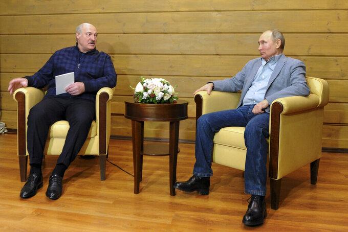 Russian President Vladimir Putin, right, listens to Belarusian President Alexander Lukashenko during their meeting in the Black Sea resort of Sochi, Russia, Monday, Feb. 22, 2021. (Alexei Druzhinin, Sputnik, Kremlin Pool Photo via AP)