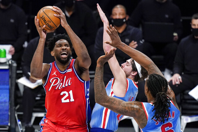 Philadelphia 76ers' Joel Embiid (21) shoots over Brooklyn Nets' Joe Harris (12) during the first half of an NBA basketball game Thursday, Jan. 7, 2021, in New York. (AP Photo/Frank Franklin II)