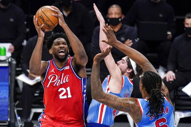 Philadelphia 76ers' Joel Embiid (21) shoots over Brooklyn Nets' Joe Harris (12) during the first half of an NBA basketball game Thursday, Jan. 7, 2021, in New York. (AP Photo/Frank Franklin II)
