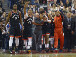 Toronto Raptors guard Patrick McCaw (22) leaves the court with help from players and staff after an injury during the first half of an NBA basketball game against the Philadelphia 76ers, Wednesday, Jan. 22, 2020 in Toronto. (Nathan Denette/The Canadian Press via AP)