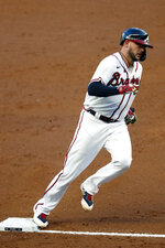 Atlanta Braves' Tyler Flowers rounds third base after hitting a home run in the second inning of a baseball game against the Toronto Blue Jays Tuesday, Aug. 4, 2020, in Atlanta. (AP Photo/John Bazemore)