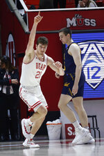 Utah forward Riley Battin (21) celebrates after scoring against California during the first half of an NCAA college basketball game Saturday, Feb. 8, 2020, in Salt Lake City. (AP Photo/Rick Bowmer)