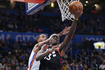 Toronto Raptors forward Pascal Siakam (43) shoots in front of Oklahoma City Thunder guard Terrance Ferguson during the first half of an NBA basketball game Wednesday, Jan. 15, 2020, in Oklahoma City. (AP Photo/Sue Ogrocki)