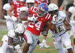 CORRECTS TO SECOND HALF - Southeastern Louisiana defensive backs Dejion Lynch (6) and Derek Turner II (18) tackle Mississippi running back Snoop Conner (24) during the second half of an NCAA college football game in Oxford, Miss., Saturday, Sept. 14, 2019. Mississippi won 40-29. (AP Photo/Thomas Graning)