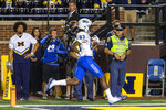 Middle Tennessee wide receiver Jimmy Marshall (83) rushes for a touchdown during the fourth quarter of the team's NCAA football game against Michigan in Ann Arbor, Mich., Saturday, Aug. 31, 2019. Michigan won 40-21. (AP Photo/Tony Ding)
