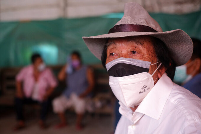 An elderly Naga waits in the recovery room after receiving the vaccine for COVID-19 in Imphal, India, Tuesday, July 13, 2021. (AP Photo/Yirmiyan Arthur)
