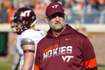 Virginia Tech defensive coordinator Bub foster watches his team warm up before an NCAA college football game against Virginia in Charlottesville, Va., Friday, Nov. 29, 2019. (AP Photo/Steve Helber)