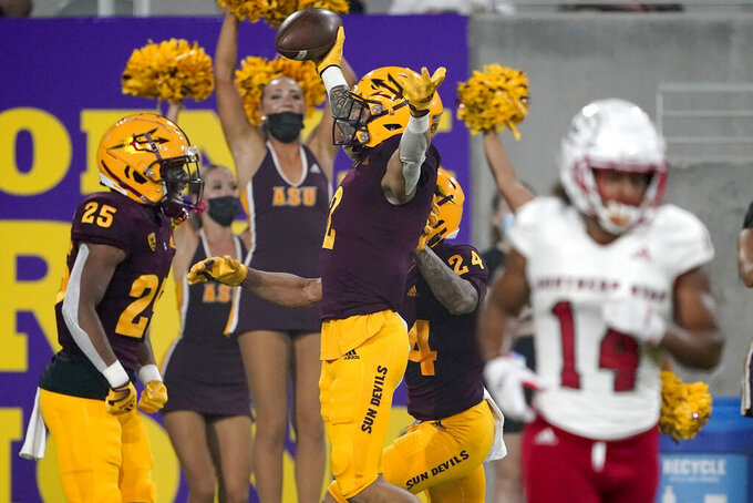 Arizona State defensive back DeAndre Pierce (2) celebrates his interception with defensive back Macen Williams (25) as Southern Utah wide receiver Lance Lawson (14) leaves the field during the first half of an NCAA college football game, Thursday, Sept. 2, 2021, in Tempe, Ariz. (AP Photo/Matt York)