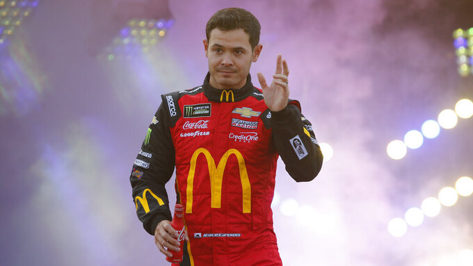 Kyle Larson waves to fans during driver introductions prior to the start of the NASCAR Cup series auto race at Richmond Raceway in Richmond, Va., Saturday, April 13, 2019. (AP Photo/Steve Helber)