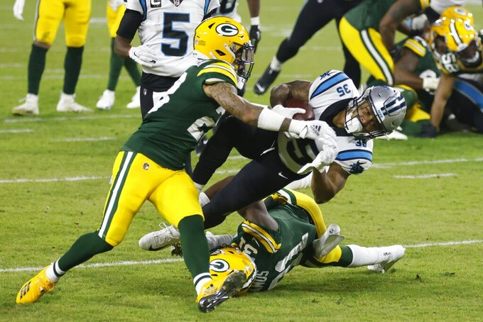 Green Bay Packers' A.J. Dillon stops Carolina Panthers' Rodney Smith during the first half of an NFL football game Saturday, Dec. 19, 2020, in Green Bay, Wis. (AP Photo/Matt Ludtke)