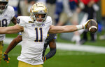 Notre Dame wide receiver Ben Skowronek (11) celebrates as he goes in the end zone past Pittsburgh defensive back A.J. Woods (25) for a touchdown after making a catch during the first half of an NCAA college football game, Saturday, Oct. 24, 2020, in Pittsburgh. (AP Photo/Keith Srakocic)