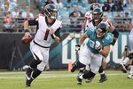Atlanta Falcons quarterback Danny Etling (1) scrambles past Jacksonville Jaguars defensive tackle Taven Bryan (90) during the first half of an NFL preseason football game Thursday, Aug. 29, 2019, in Jacksonville, Fla. (AP Photo/Phelan M. Ebenhack)