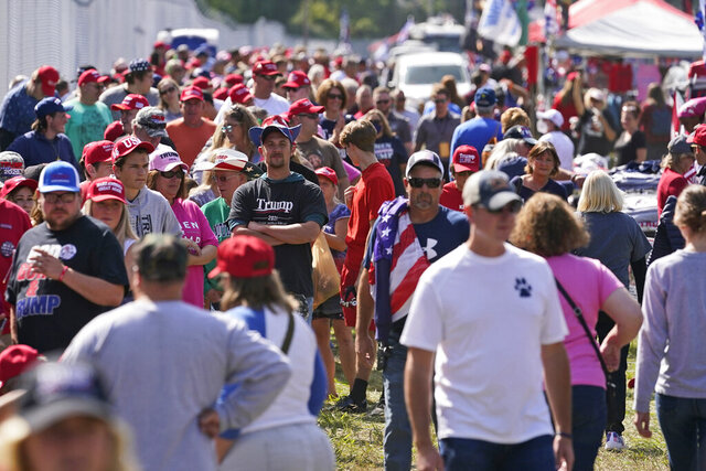 Long lines are shown waiting outside the location where President Donald Trump will speak at a campaign rally, Monday, Sept. 21, 2020, in Swanton, Ohio. (AP Photo/Tony Dejak)
