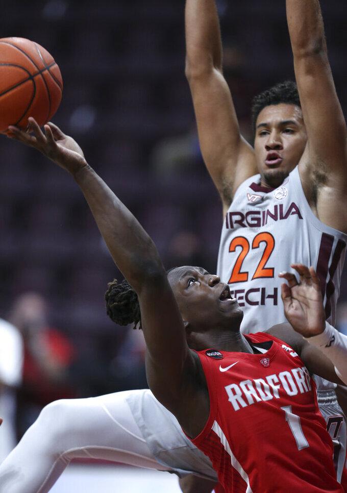Radford's Keishon Porter (1) attempts to shoot past Virginia Tech's Keve Aluma (22) during the second half of an NCAA college basketball game, Wednesday Nov. 25, 2020, in Blacksburg Va. (Matt Gentry/The Roanoke Times via AP)