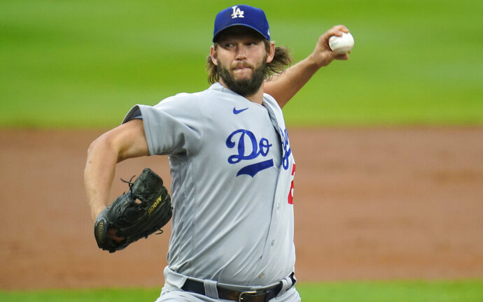 Los Angeles Dodgers starting pitcher Clayton Kershaw works against the Colorado Rockies during the first inning of a baseball game Saturday, Sept. 19, 2020, in Denver. (AP Photo/David Zalubowski)