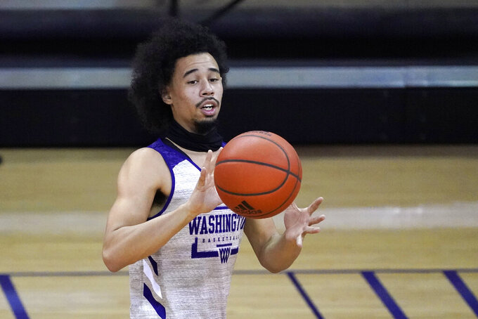 Washington's Nate Pryor passes during an NCAA college basketball practice Tuesday, Oct. 27, 2020, in Seattle. Pryor is among several transfers to Washington who the Huskies are hopeful can all make an immediate impact. (AP Photo/Elaine Thompson)