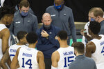 Seton Hall head coach Kevin Willard, center, talks to his players during a timeout against Oregon in the first half of an NCAA college basketball game in Omaha, Neb., Friday, Dec. 4, 2020. (AP Photo/Kayla Wolf)