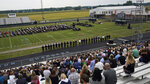 Mourners gather for the funeral of Navy Corpsman Maxton Soviak at Edison High School Stadium, Monday, Sept. 13, 2021, in Milan, Ohio. Soviak was one of 13 U.S. troops killed in a suicide bombing at Afghanistan's Kabul airport on Aug. 26. (AP Photo/Tony Dejak)