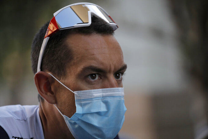 Australia's Richie Porte wears a face mask as he arrives for the 107th Tour de France cycling race team presentation, in Nice, southern France, Thursday, Aug. 27, 2020 ahead of upcoming Saturday's start of the race. The Tour de France sets off shrouded in uncertainty and riding in the face of the coronavirus pandemic and mounting infections in France. (AP Photo/Christophe Ena)