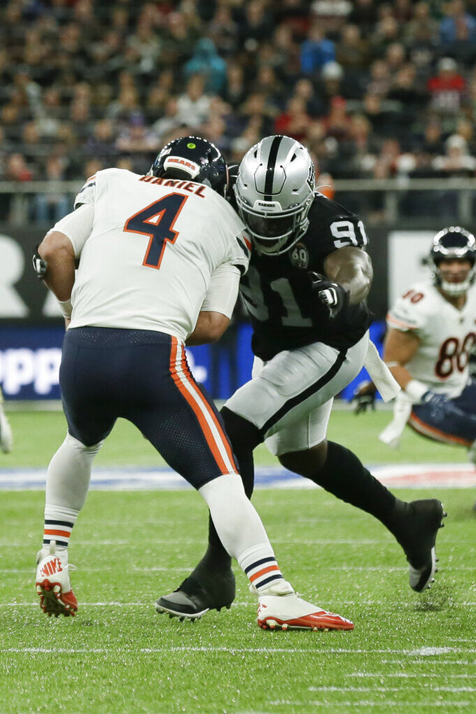 Chicago Bears quarterback Chase Daniel (4) is sacked by Oakland Raiders defensive end Benson Mayowa (91) during the first half of an NFL football game at Tottenham Hotspur Stadium, Sunday, Oct. 6, 2019, in London. (AP Photo/Tim Ireland)