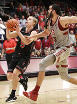 Utah guard Parker Van Dyke (5) drives to the basket against Stanford center Josh Sharma during the second half of an NCAA college basketball game in Stanford, Calif., Thursday, Jan. 24, 2019. (AP Photo/Jeff Chiu)