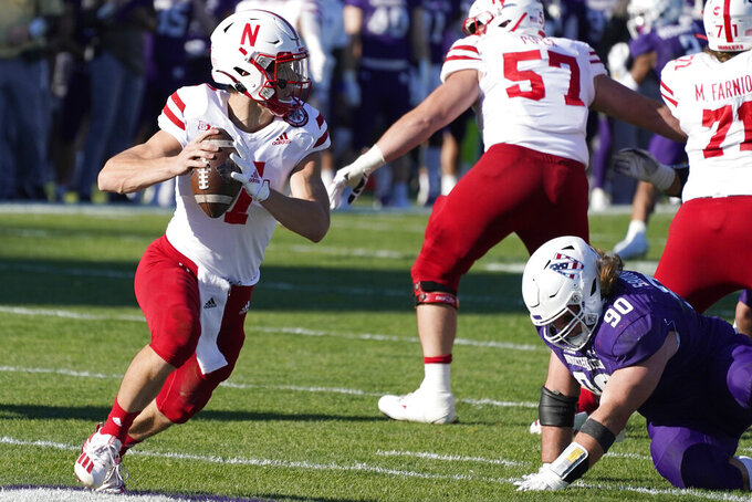 Nebraska quarterback Luke McCaffrey, left, looks to pass during the second half of an NCAA college football game against Northwestern in Evanston, Ill., Saturday, Nov. 7, 2020. Northwestern won 21-13. (AP Photo/Nam Y. Huh)