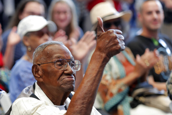 FILE - In this Sept. 12, 2019 file photo, World War II veteran Lawrence Brooks celebrates his 110th birthday at the National World War II Museum in New Orleans.  Brooks celebrated his 112th birthday, Sunday, Sept. 12, 2021 with a drive-by party at his New Orleans home hosted by the National War War II Museum.   Drafted in 1940, Brooks was a private in the Army's mostly Black 91st Engineer Battalion.   (AP Photo/Gerald Herbert, File)