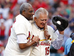 FILE - In this May 17, 2017, file photo, Bob Gibson, left, and Tim McCarver, members of the St. Louis Cardinals' 1967 World Series championship team, take part in a ceremony honoring the 50th anniversary of the victory, before a game between the Cardinals and the Boston Red Sox in St. Louis. Gibson is fighting pancreatic cancer. The St. Louis Post-Dispatch said the 83-year-old Hall of Famer was diagnosed with the cancer several weeks ago and revealed the news Saturday, July 13, 2019, to the other living Hall of Famers. (AP Photo/Jeff Roberson, File)