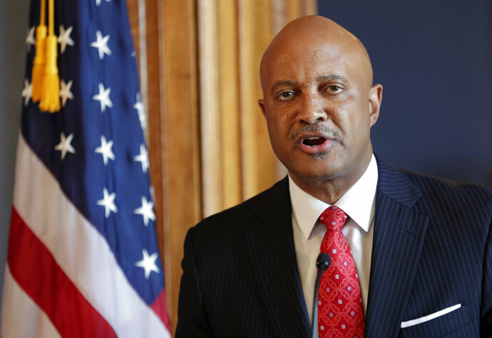 FILE - In this July 9, 2018, file photo, Indiana Attorney General Curtis Hill speaks during a news conference at the Statehouse in Indianapolis. Lawyers for Hill argue that allegations he drunkenly groped four women during a party don't meet the legal standard of a misuse of power. Court documents filed on the Republican state attorney general's behalf call for the women's federal lawsuit against him to be thrown out by a judge.  (AP Photo/Michael Conroy, File)